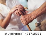young woman holding hand of old ... | Shutterstock . vector #471715331