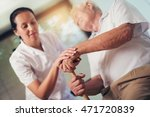 young woman holding hand of old ... | Shutterstock . vector #471720839