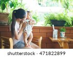 asian mother holding her son | Shutterstock . vector #471822899
