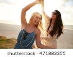 outdoor shot of two young women ... | Shutterstock . vector #471883355