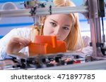 young woman work with 3d printer | Shutterstock . vector #471897785