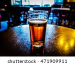 Small photo of High dynamic range (HDR) Vintage looking pint of English bitter ale in a pub