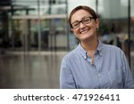 woman smiling and looking at... | Shutterstock . vector #471926411