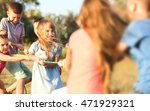 happy kids playing in park | Shutterstock . vector #471929321
