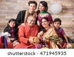 indian family celebrating... | Shutterstock . vector #471945935
