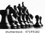 Close up of black chess pieces foucs on the queen - stock photo