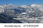 Small photo of Village Saanen and snow covered mountains. Winter scene in the Swiss Alps.
