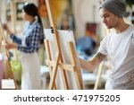 male artist dressed in beanie... | Shutterstock . vector #471975205