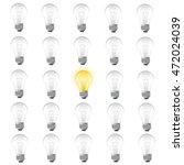 one burning bulb among not...   Shutterstock .eps vector #472024039