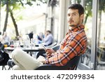 attractive man sitting in cafe... | Shutterstock . vector #472099834