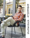 attractive man sitting in cafe...   Shutterstock . vector #472099849