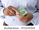 man checking or counting... | Shutterstock . vector #472145545