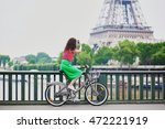 Cheerful Young Woman Riding A...