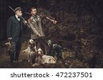 two hunters with dogs and... | Shutterstock . vector #472237501