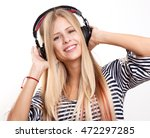 young woman with headphones... | Shutterstock . vector #472297285