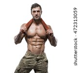 young handsome muscular man... | Shutterstock . vector #472313059