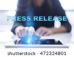 """Small photo of Woman is using tablet pc, pressing on virtual screen and select """"Press Release"""""""