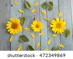 Yellow Flowers On Blue Wooden...