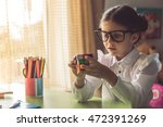 Charming Little Girl In School...