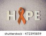 orange ribbons and hope letter... | Shutterstock . vector #472395859