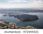 Aerial picture of Stanley Park and Downtown Vancouver, BC, Canada, during a cloudy sunrise. - stock photo