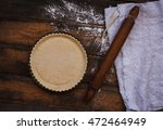 Empty Pie Crust Over Old Woode...