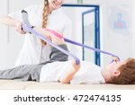 young physiotherapist and boy... | Shutterstock . vector #472474135