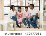 happy indian family at living... | Shutterstock . vector #472477051