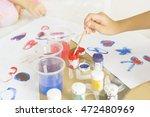 hands of painting little boy | Shutterstock . vector #472480969