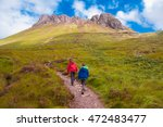 Two Kids Walking Trail To Stac...