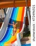 child on water striped slide... | Shutterstock . vector #472496521