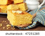 Stock photo still life of freshly baked homemade cornbread with butter melting on top close up with shallow 47251285
