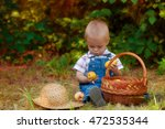 little boy with a basket of... | Shutterstock . vector #472535344