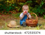 little boy with a basket of... | Shutterstock . vector #472535374