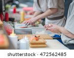 cooks making japanese susi in... | Shutterstock . vector #472562485