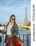 Small photo of Get your bags ready for the Paris autumn sales. young fashion-monger in sunglasses with shopping bags in Paris, France looking aside