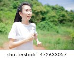 asian woman running in the park | Shutterstock . vector #472633057