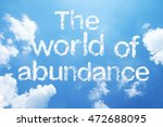 "Small photo of ""The world of abundance"" cloud word on sky."