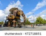 Small photo of NANTES, FRANCE - CIRCA SEPTEMBER 2015: The Great Elephant goes for a walk with passengers aboard.