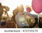 bride looks at her bouquet... | Shutterstock . vector #472725175