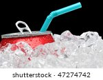Close up of a Soda Can in a bed of ice pop top open with a straw sticking out over black background horizontal format - stock photo