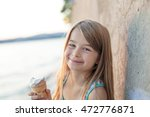 a beautiful little girl eats... | Shutterstock . vector #472776871