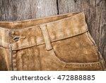 brown jeans on wooden board | Shutterstock . vector #472888885