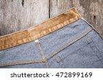brown jeans on wooden board | Shutterstock . vector #472899169