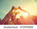 friends enjoying outdoors with... | Shutterstock . vector #472995685