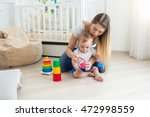 beautiful young mother playing...   Shutterstock . vector #472998559
