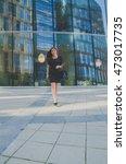 business girl in black is on... | Shutterstock . vector #473017735