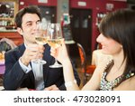 couple toasting wineglasses in... | Shutterstock . vector #473028091