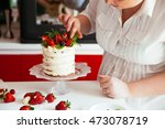 woman carefully icing the cake... | Shutterstock . vector #473078719