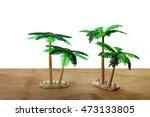 miniature palm trees on wooden... | Shutterstock . vector #473133805